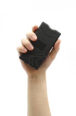 Photo pour Taser rectangulaire noir en main isolé sur blanc - image libre de droit
