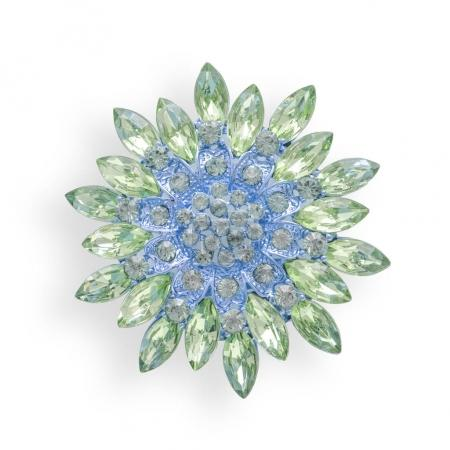 Flower brooch with diamonds isolated on white