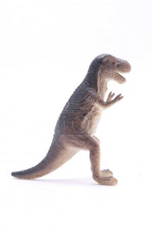 Tyrannosaurus dinosaur toy isolated on white