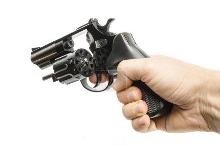 Revolver, gun, pistol in hand isolated on white