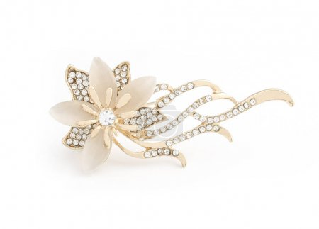 gold brooch flower with gems and moon stone isolated on white