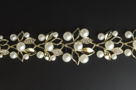 golden necklace with pearls isolated
