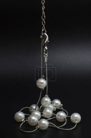 silver necklace chain with pearls isolated on black