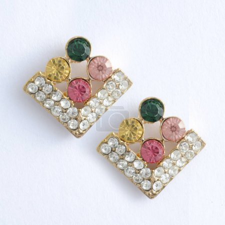 gold rhombuses earrings with gem stones isolated on white