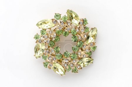 round brooch with gems isolated on a white background