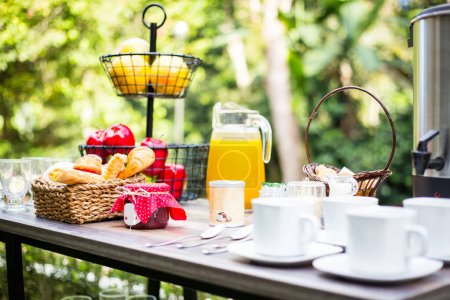 Photo for Breakfast served with coffee, juice, croissants and fruits. - Royalty Free Image