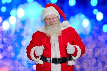 Santa Claus on blue shiny background.