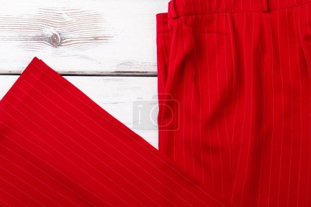 Feminine red classic trousers.