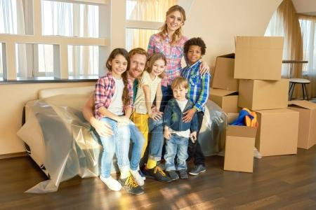 Photo for Happy family, relocation. Smiling people and carton boxes. - Royalty Free Image