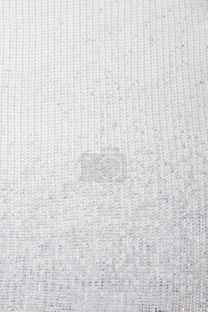 Foto de Textura vertical de lana blanca. Cerca de material textil. - Imagen libre de derechos