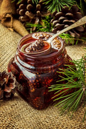 Home-made jam from pine cones. Selective focus.