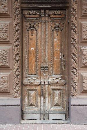 Old vintage wooden door brown. Architectural details