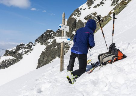 The skier prepares skis for riding.