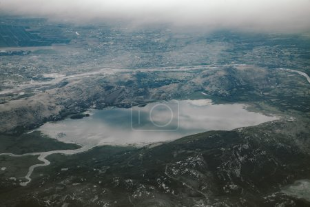 Aerial view on nature landscape to lake and mountains