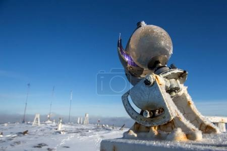 Campbell-Stokes sunshine recorder near meteorological station at winter
