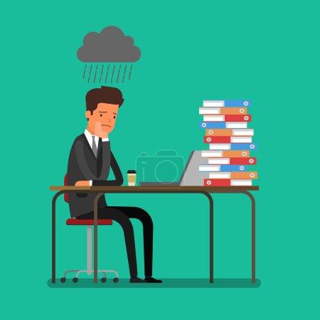 sad worker sitting behind desk
