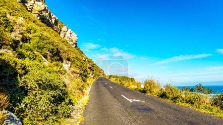 The road to Chapman's Peak along the Atlantic coast at the Slangkop Lighthouse near the village of Het Kommetjie