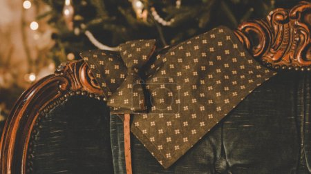 Photo for Beautiful brown classic polka dot bow tie , cufflinks, men's scarf and neck tie on wooden present box - Royalty Free Image