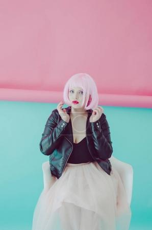 young woman with pink hair and red lipstick