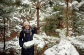 girl in a pine forest in the snow