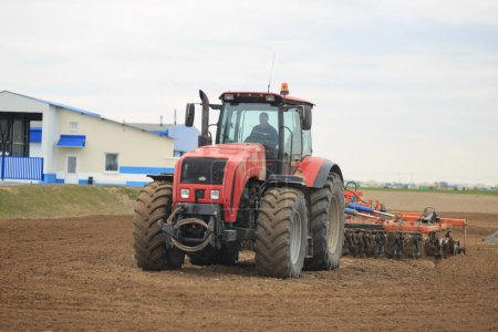 GOMEL, BELARUS - 19 APRIL 2017: Belarus tractor cultivates a piece of land.