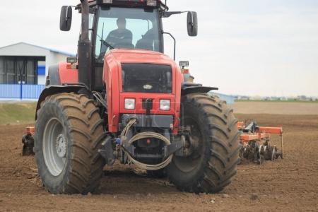 GOMEL, BELARUS - 19 APRIL 2017: Belarus tractor cultivates a piece of land.