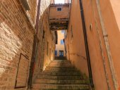 Urbino, Italy - August 9, 2017: a narrow tunnel. the passage between residential buildings.