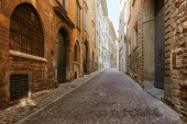 Bergamo, Italy - August 18, 2017: Quiet and narrow streets of the old town of Bergamo.