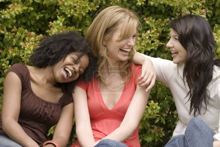 Photo for Happy diverse group of women laughing together. - Royalty Free Image
