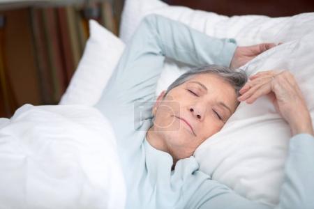 Elderly woman sleeping.