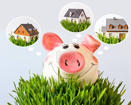 economy and finance - piggy bank with  dreamed house - savings for a new house