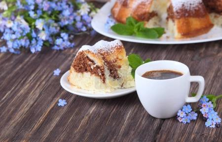 Pieces of marble cake sprinkled with powdered sugar and flowers