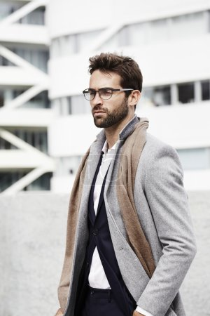 Handsome businessman in coat and scarf