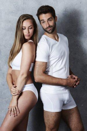 Beautiful couple in white underwear