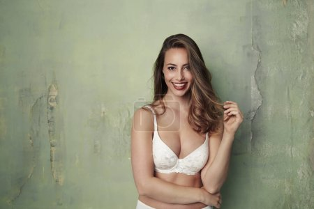 Beautiful woman smiling in bra