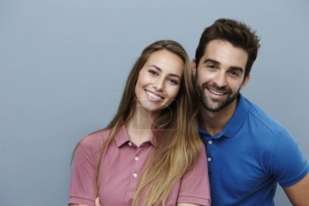 Smiling couple in polo shirts