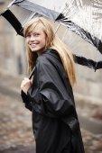 Blond woman under umbrella