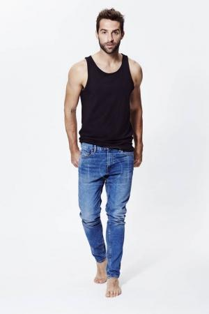 Barefoot handsome man in jeans