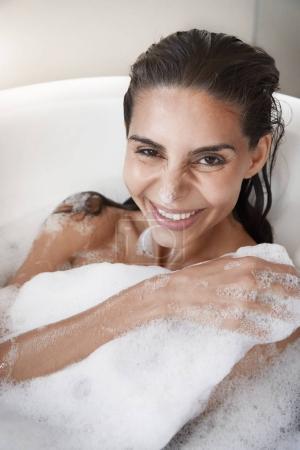Beautiful woman smiling in bath
