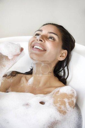 Beautiful woman playing in bath