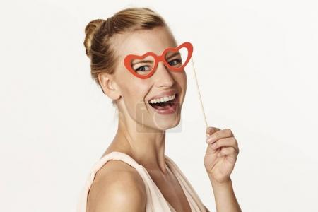 Woman laughing in heart shaped spectacles