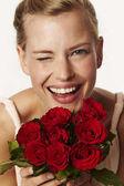 Girl holding red flowers
