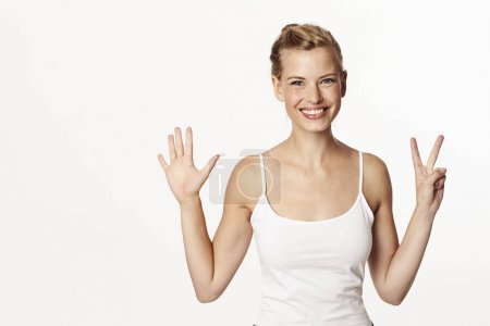 Blond woman counting with fingers