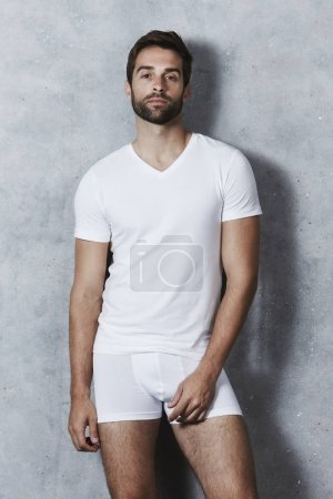Man in white t-shirt and underpants