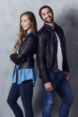 Laughing couple in leather jackets