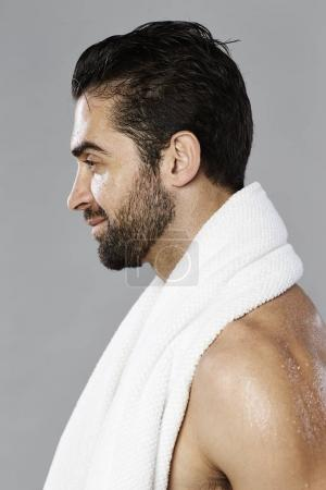 Hot guy holding towel