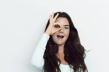 Brunette woman with ok sign