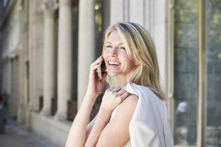 Lady gets good news on Smartphone