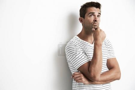 Man doing thinking gesture