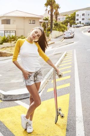 Cool girl posing with longboard